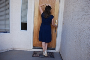 blue dress walking into house