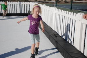young girl learning how to ice skate